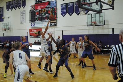 Glen Este's Kelly Simon goes up for a floater in the lane against Northwest on Dec. 9. Simon scored 17 points.