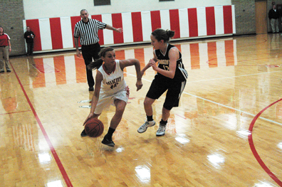 Felicity-Franklin senior guard Kelsey Arkenau dribbles around a Georgetown defender during the Lady Cardinals' loss to the Lady G-Men on Dec. 12.