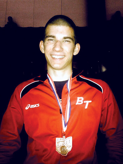 Peters poses with his state medal.