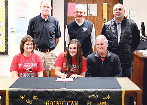 MacKenzi Carrington, a senior at Georgetown High School, signs her letter of intent to play for the defending USCAA National Champion UC Clermont Lady Cougars at a ceremony held at the high school on April 11.