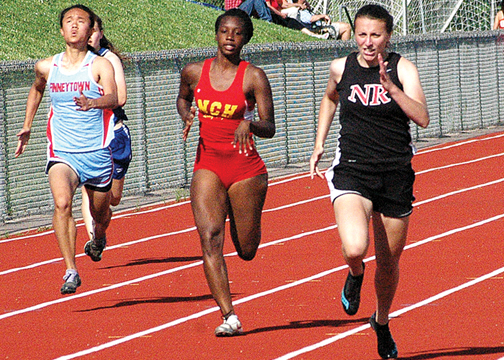 New Richmond's Olivia Behymer, right, was named the American Division Runner of the Year for the third consecutive year. She notched her best finish at the state meet this season with a fourth-place in the 400-meter dash.