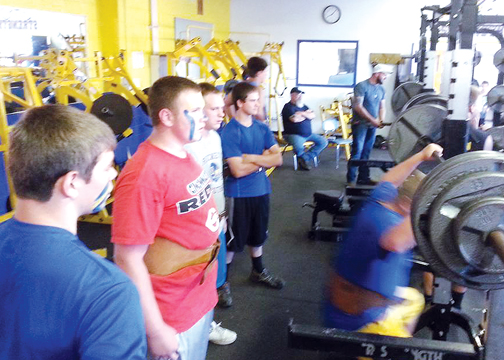 The Clermont Northeastern football team painted up and invited parents in to a Midnight Maxout lifting exhibition as the team, under first-year head coach Scott Gildea, prepared for the fall season.