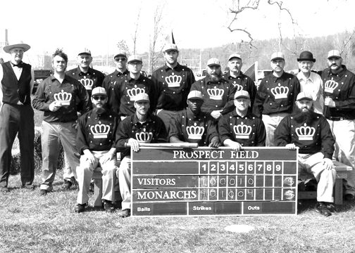 The Moscow Monarchs pose with their Prospect Field scoreboard following a game earlier this season. The Monarchs play 1860s-style baseball, which involves different rules and encourages proper etiquette.