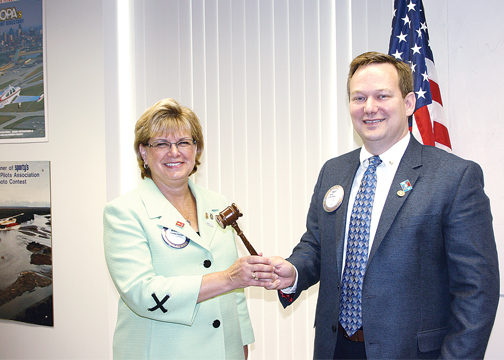 Michael Chapman passes the Batavia Rotary Gavel to Jennifer Fischer, who will serve as President of the club until July 1, 2015.