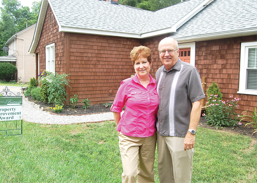 Ken and Debby Welsh stand in front of their renovated home on Riverside Drive in the village of Batavia. The Welsh's received the Village Association of Batavia's Property Improvement Award for June.