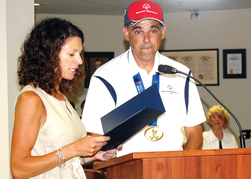 Special Olympian gold medalist Johnny Vilardo was honored by the Milford City Council on July 1.