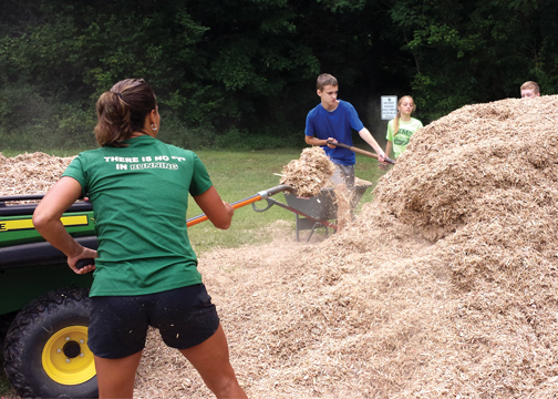 The Batavia middle school and high school cross country teams and their families worked on the teams' new course at the Batavia Township Center on Aug. 8.