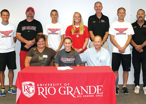 Williamsburg track standouts Caley Pringle and Cody Minnie signed National Letters of Intent to continue their athletic careers at the University of Rio Grande. Pictured are, seated, from left to right, Sherry Pringle, Caley Pringle and Gary Pringle; standing, Rio Grande director of cross country/track & field Steve Gruenberg, Rio Grande assistant coach Burt Wood, Rio Grande assistant coach Yulia Vasilyeva, Rio Grande assistant coach Mary Beth Schramm, Rio Grande head coach Bob Willey, Rio Grande assistant coach Nick Wilson, Rio Grande assistant coach Glen Queen.