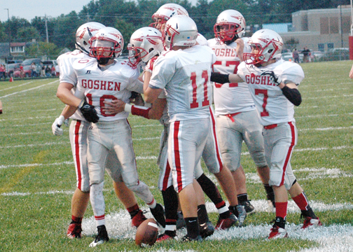 The Warriors celebrate a scoring drive earlier this season. The offensive unit, seen above, has seen fresh faces step in as needed.