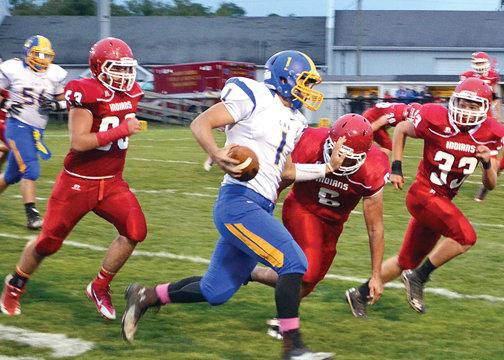 Clermont Northeastern quarterback Shawn Lykins rushes around the end against Hillsboro on Sept. 12.