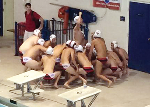 The Milford boys' water polo team gets hyped up before a match on Aug. 23 at the St. Xavier Invitational. The boys' team is currently 8-6-1 and has nearly doubled their win total from 2013.