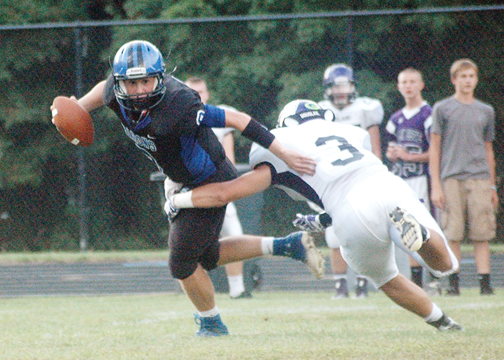 Amelia quarterback Ty Nicodemus escapes a tackle during Week One against Glen Este.