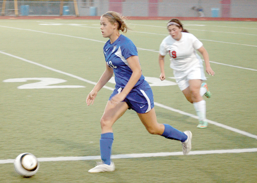 Amelia's Abby Brown, 18, dribbles away from New Richmond's Bergen Workman, 12, earlier this season. Both teams made it to sectional finals in the postseason before losing to higher seeded opponents.