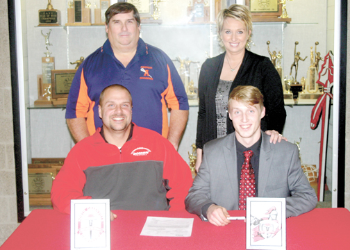 Jiles Munafo, seated right, signed his National Letter of Intent to attend North Greenville University as his father, Chris, seated left, his club lacrosse coach, Todd Shelton, standing left, and mother, Cori, standing right, look on.