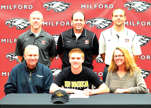Milford's Cameron Roth, seated center, signs a NLI to play baseball at Ohio Dominican University as his parents, Brett and Theresa, and coaches look on.