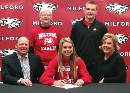 Milford High School's Megan Creager, seated center, signs to play with the Youngstown State University Penguins next fall during a ceremony held at the school on