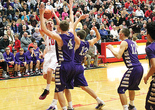 Milford junior Brad Hall goes up for a contested layup during the Eagles' 48-33 win over Glen Este on Jan. 16. The win was Milford's 11th consecutive victory.