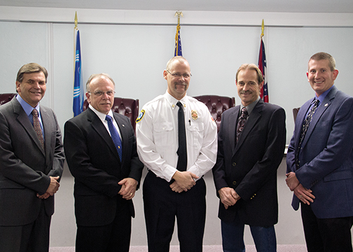 From left, Trustee Guy Bainum, Chair Gary Jordan, Emergency Services Chief Kevin Wiedemann, Trustee Bari Henning and Fiscal Officer Greg Carson celebrate Wiedemann's appointment as chief at the trustees' Jan. 26 meeting.