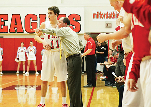 Milford coach Joe Cambron instructs senior Will Hannah during the Eagles' win against Kings on Feb. 6. (Photo by Jeff Sullivan)