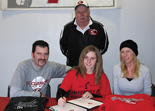 Bethel-Tate senior Cassidy DeVore signs to play softball at UC Clermont as her parents, Terry and Linda, and UC Clermont head coach Dan Kinney look on.