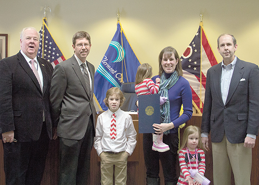 From left, Commissioner Ed Humphrey, Board of Developmental Disabilities Superintendent Dan Ottke, Evan Chesnut, Nora Chesnut, Volunteer Board Member Emily Chesnut, Katie Chesnut and Commissioner David Uible after the commissioners proclaimed March 2015 as Developmental Disabilities Awareness Month on Feb. 25.