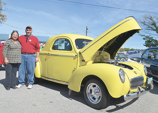 Siblings Doug Stephens, of Reading, and Kim Hughes, of Montgomery, stand with their father's 1942 Willy's sedan at the Pumpkin Run Nationals, held Oct. 2-4 at the Clermont County Fairgrounds. Their father, Charlie Stephens, of Deer Park, passed away in February, and the two paid tribute to him by exhibiting the car at the event.