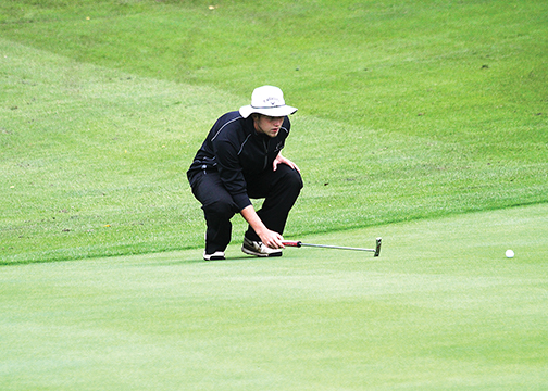 Bethel-Tate senior Mitchell McElfresh reads a putt during the sectional tournament on Oct. 1 at Sharon Woods Golf Course. McElfresh shot a 79 to advance.