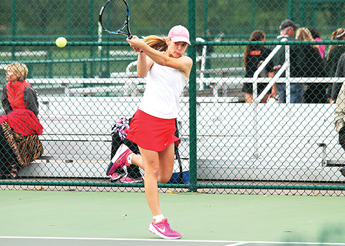 Milford sophomore Amanda Reinhart competes in the sectional tournament at Mason on Oct. 1.