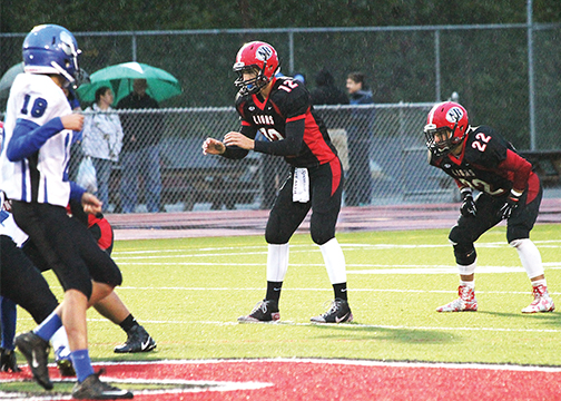 New Richmond quarterback Austin Torrens, left, and running back Michael Williamson, right, led the Lions to victory over Amelia on Oct. 2, 36-6.