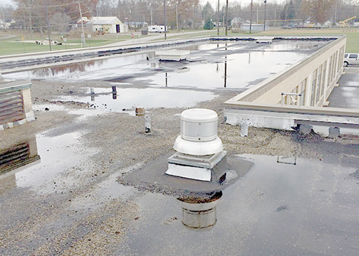 Pictured is the east wing of Hill Intermediate School, in Bethel, which will get a new roof by next fall. The surface of the roof has deteriorated, and the drainage system is not effective because of the condition of the roof, according to officials.