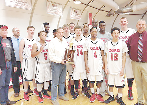 The UC Clermont Cougars pose with the Phil Sinkovich Basketball Classic trophy as well as Sinkovich himself, center,  following their win on Saturday, Nov. 21.