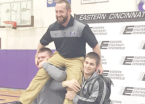 Glen Este head coach Chris Redmond is carried off on the shoulders of two of his wrestlers after being named the ECC Coach of the Year on Feb. 5.