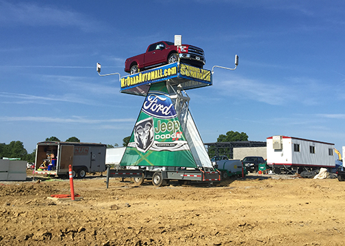 Mt. Orab Ford will be open for business on August 5, according to General Manager Mike Carmichael.  Advertising on the site includes a truck 25 feet in the air on a spinning platform.