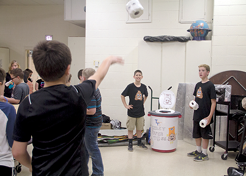 From left, Clermont Northeastern Elementary fifth grade students Justin Leach and Gavin Bayliff created a game called the Toilet Paper Toss as their project for Market Day on May 19, 2016.