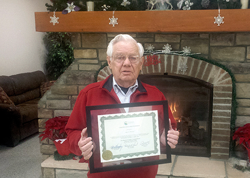 Joel T. Wilson died on June 21, 2016. He is pictured at a party for his 60th anniversary as a auctioneer on Dec. 16, 2015 holding a certificate from the Clermont County Commissioners recognizing him for his service.
