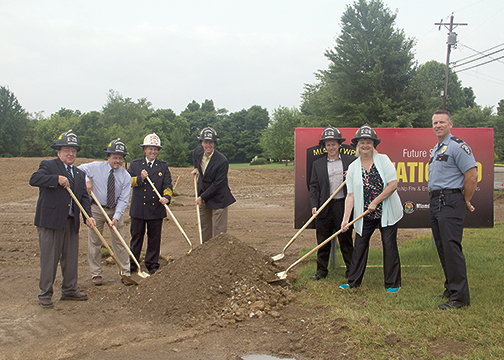 From left, Miami Township Trustee Karl Schultz, Service Director John Musselman, Fire and Emergency Medical Services Chief Steve Kelly, Trustee Ken Tracy, Administrator Jeff Wright, Trustee Mary Makley Wolff and Assistant Police Chief Mike Mills pose during the groundbreaking ceremony for Station 29 on June 23, 2016.