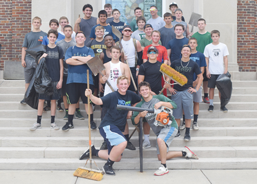 The Batavia Bulldogs football team gathered early on July 14, 2016 for their second-annual Village of Batavia clean-up.