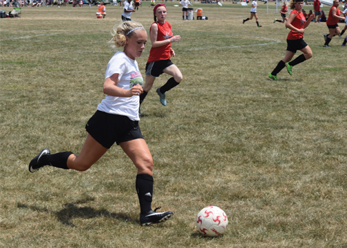 New Richmond's Madison Lanter dribbles the ball up the field for the Lady Lions in their victory over the Bethel-Tate Lady Tigers in Mason on July 23, 2016.