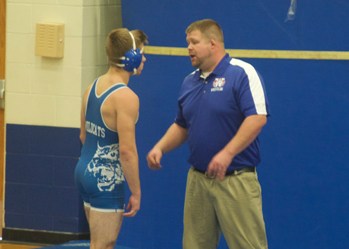 Williamsburg head coach Brandon Dean offers some advice to one of his wrestlers during the Bob Guy Invitational on Saturday, Dec. 3, 2016.