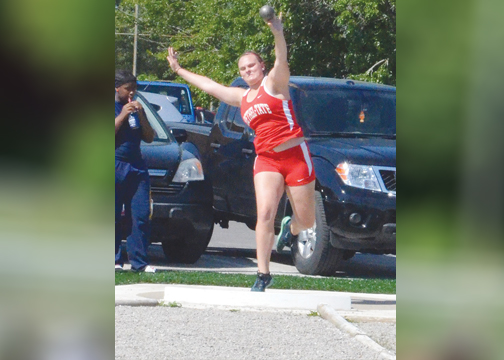 Bethel-Tate's Brooke Stiles competes in the shot put at the district track and field meet, held at New Richmond High School.