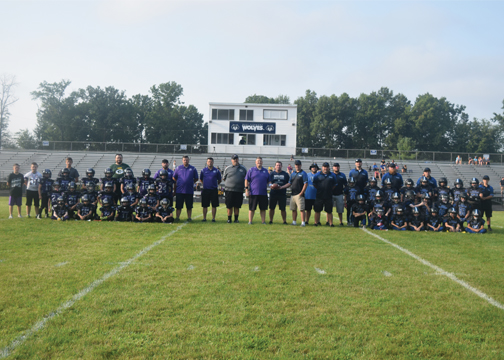 West Clermont and Glen Este youth football pose together prior to the jamboree game between the two squads at West Clermont Middle School on Saturday, August 12, 2017.