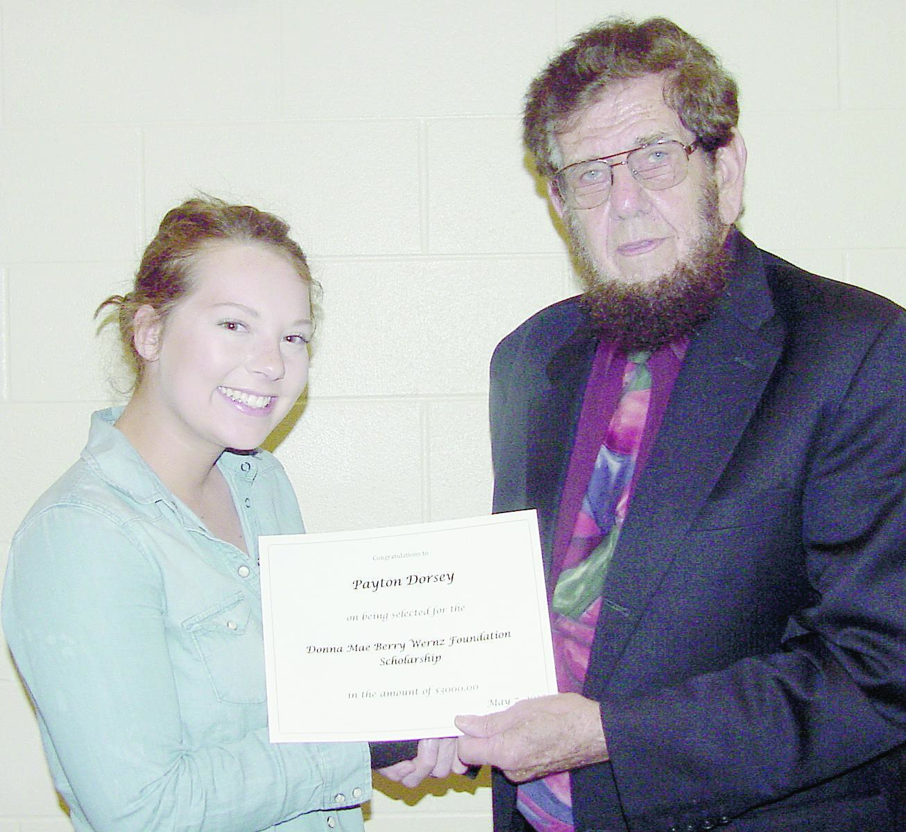 Payton Dorsey (left) received the Donna Mae Berry Wernz Foundation scholarship during the Eastern Local School District Awards Program held on May 7, 2017 at Eastern Local High School.  Payton received the three-thousand dollar ($3000.00) award in recognition of her achievements, and to assist her in pursuit of further academic studies in pre-medicine.  Payton is the daughter of Harold and Vicky Dorsey of Sardinia, and will attend Marietta College.  The Foundation was established in gratitude for the education provided to Donna Wernz at Ashridge Elementary and Russellville High School, and to recognize annually an outstanding senior at Eastern Local High School for their accomplishments.  The award was presented by Stanley Wernz.