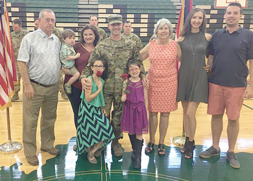 Sgt. 1st Class Brian Bailey, pictured in the center, with his wife, Judie, who is holding their 2-year-old son, Maddox, alongside their daughters, Samantha, age 7 and Isabelle, age 6, in front of him. Bailey's dad Jack is on the far left. His mom Clara Dorsey, sister Victoria Bailey and brother Jon Bailey, are to his right. The family celebrated Bailey's promotion in the military at Batavia High School on Oct. 7.
