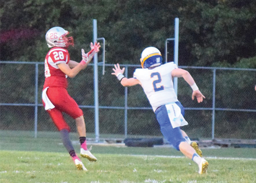 Bethel-Tate's Drake Dockery hauls in the first of his three touchdown receptions from Seth Becker in Bethel-Tate's 56-31 win on Friday, Oct. 6, 2017.