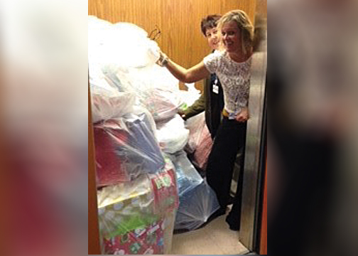 Pictured are Clermont County Children's Services employees Cathy Collins and Sanna Gast as they load toy donations for the department's Community Toy Chest program into an elevator.